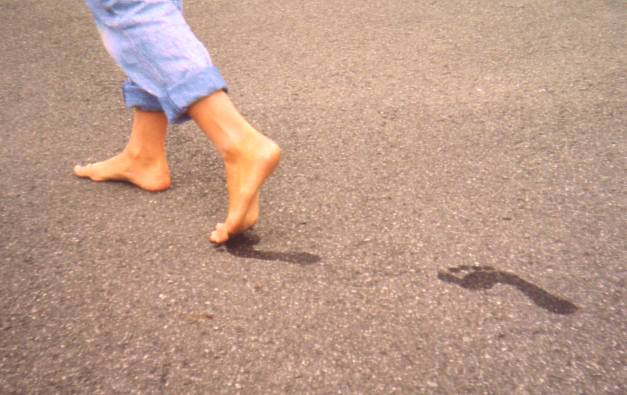 walking bare feet 7 Reasons Why You Should Dump Your Socks and Shoes